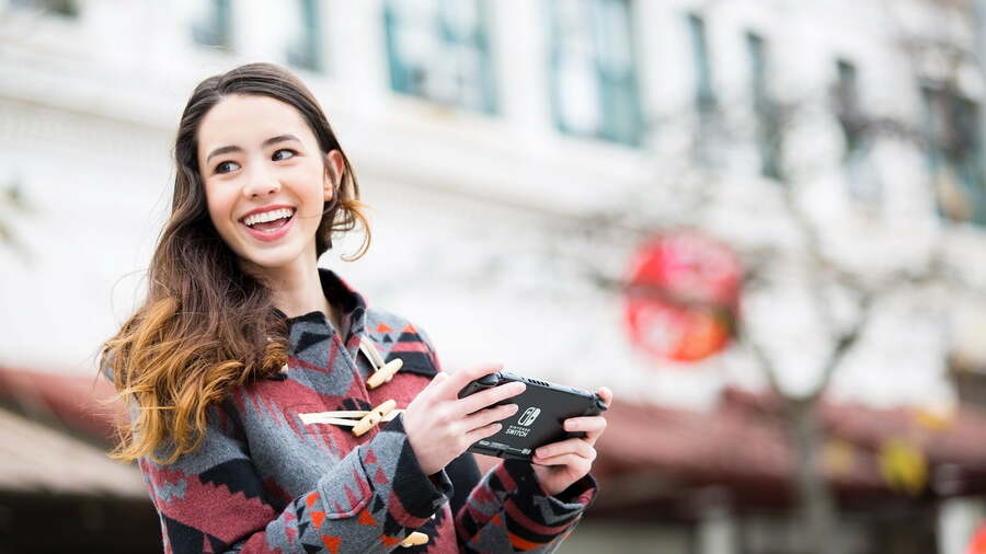 Have we not all, at some point, walked around a city playing Nintendo Switch while laughing at something just out of frame?