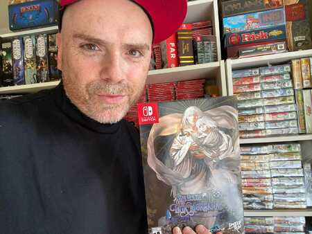 Florence with two of his favourite Switch titles