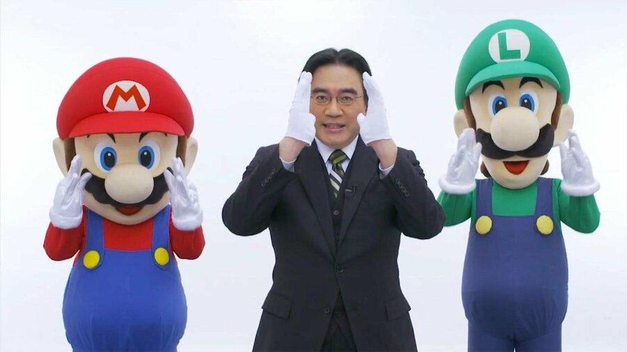 "Satoru Iwata performing his ""directly to you"" pose"