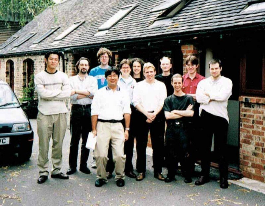 The GoldenEye 007 development team outside one of the barns at Rare's Manor Farm HQ