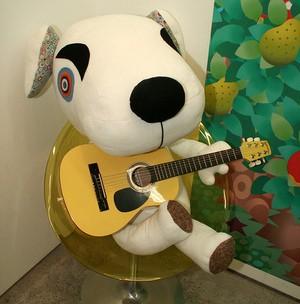 A stuffed K.K playing his guitar
