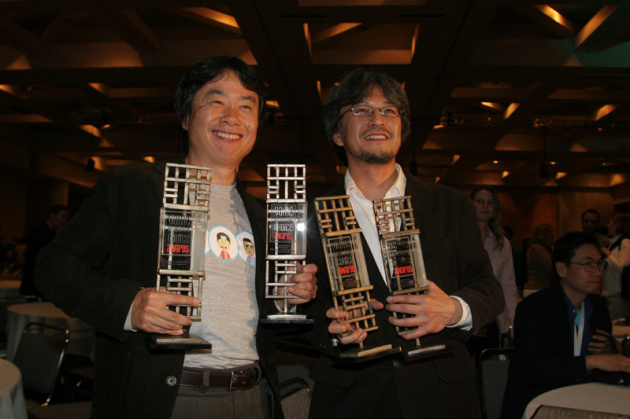 Shigeru Miyamoto and Eiji Aonuma pose with the awards