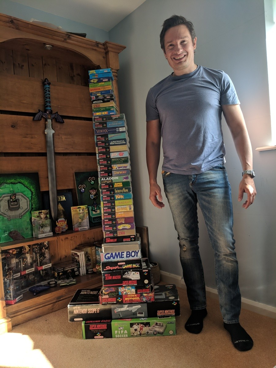 Alex with his pile of games today. As you can see, he's grown a bit since 1994.