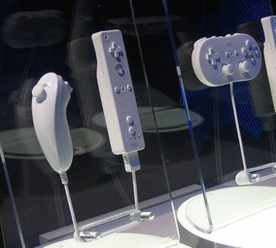 The Wiimote with two of it's available attachments