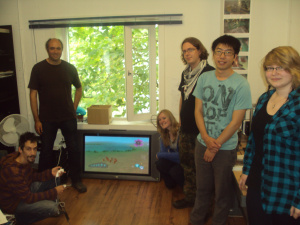 The Onteca Team with their big TV on the floor