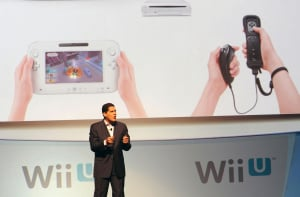 Reggie Fils-Aime is holding an experimental transparent controller