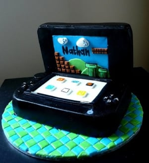 Happy Birthday 3DS - and Nathan (image via sites.google.com/site/kathysdeserts/realistic-cakes)