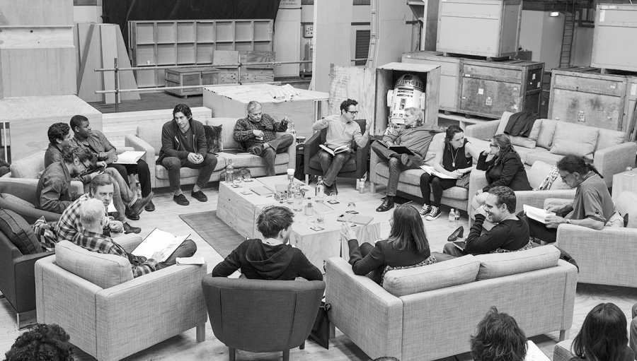 J.J. Abrams with the cast of the forthcoming sequel (and R2-D2 in a crate)