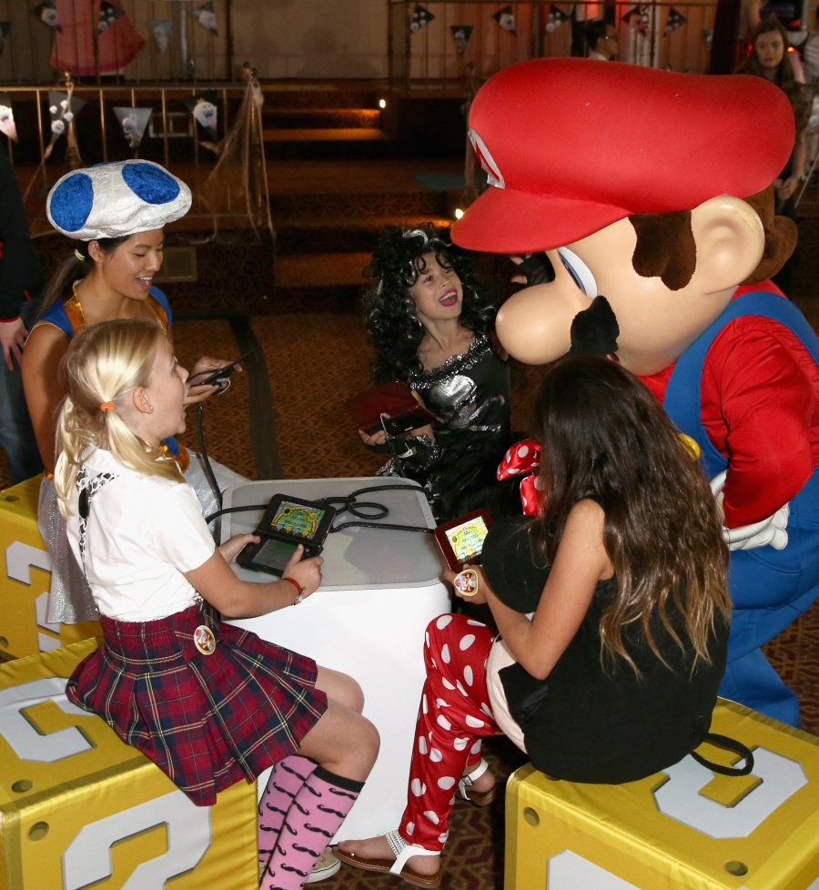 """In this photo provided by Nintendo of America, guests of Starlight Children's Foundation's """"Dream Halloween"""" event on Oct. 22 in Los Angeles got to meet Mario – one of the stars of the Mario Party Star Rush game."""